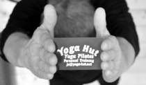 Yoga Hut business card above head
